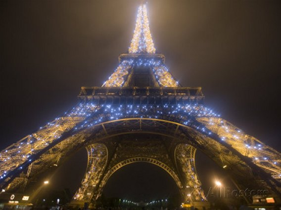 Looking Up at Eiffel Tower in Fog and Rain at Night, Paris, France