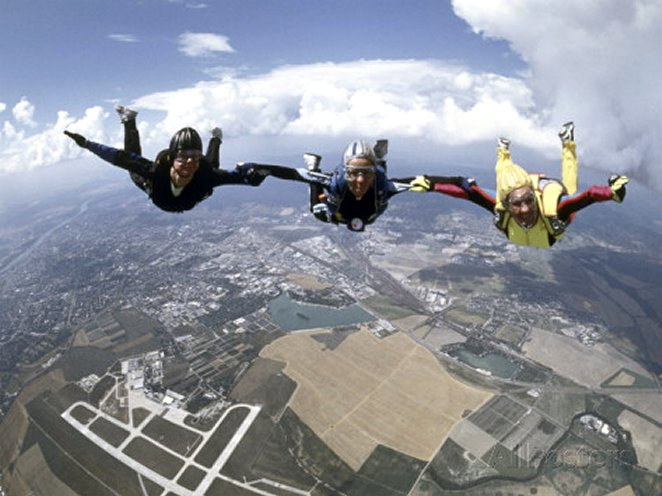 Skydivers Joining Hands