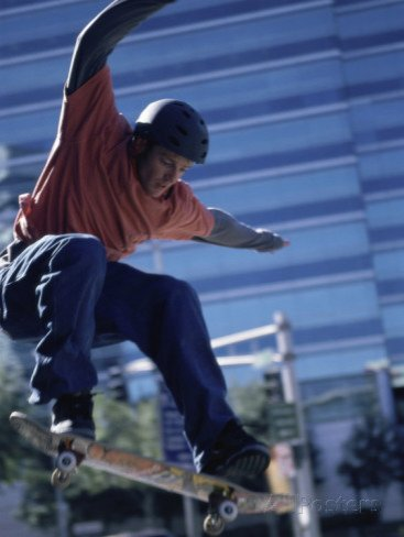 Young Man Skateboarding in Mid Air