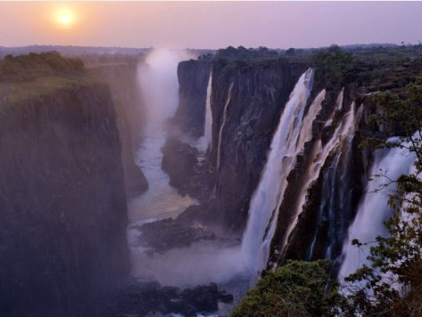 Sunset over Magnificent Victoria Falls, One of Natural Wonders of World